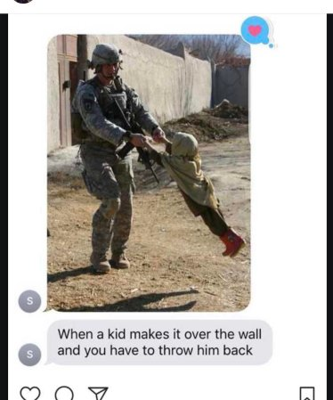 kid over wall.jpg